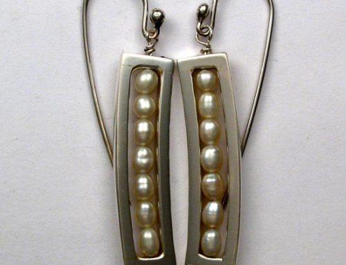 pearl earrings in silver frame